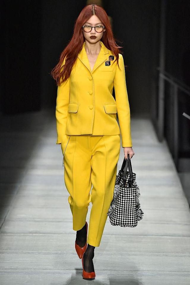 <p>Model wears a yellow pantsuit at the fall 2018 Bottega Veneta show. (Photo: Getty Images) </p>