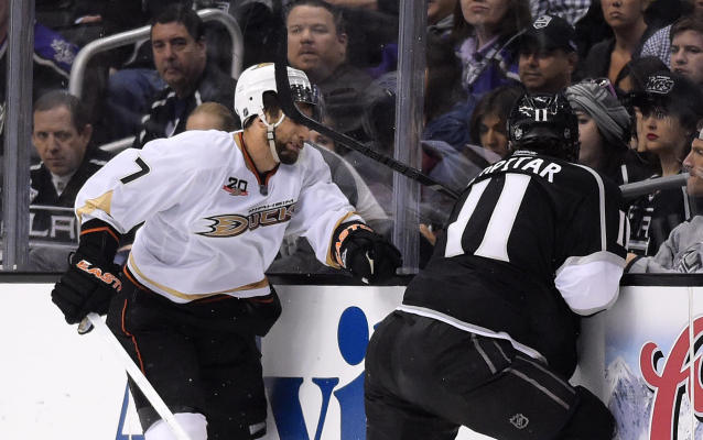 Los Angeles Kings center Anze Kopitar, right, of Slovenia, hits Anaheim Ducks center Andrew Cogliano in the face with his stick during the third period in Game 4 of an NHL hockey second-round Stanley Cup playoff series, Saturday, May 10, 2014, in Los Angeles. Kopitar received a four minute double minor for high sticking on the play. The Duck won 2-0. (AP Photo/Mark J. Terrill)