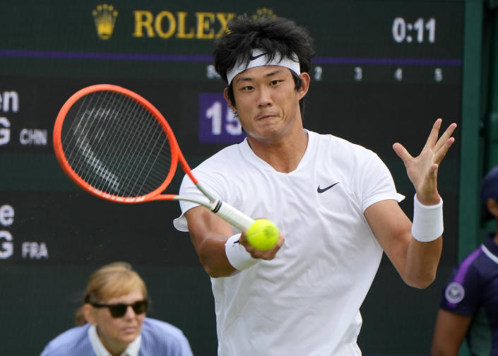 China's Zhizhen Zhang plays a return to Antoine Hoang of France during the men's singles first round match on day two of the Wimbledon Tennis Championships in London, Tuesday June 29, 2021. (AP Photo/Alastair Grant)