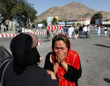 An Afghan woman weeps at the site of a suicide attack in Kabul, Afghanistan July 23, 2016. REUTERS/Mohammad Ismail