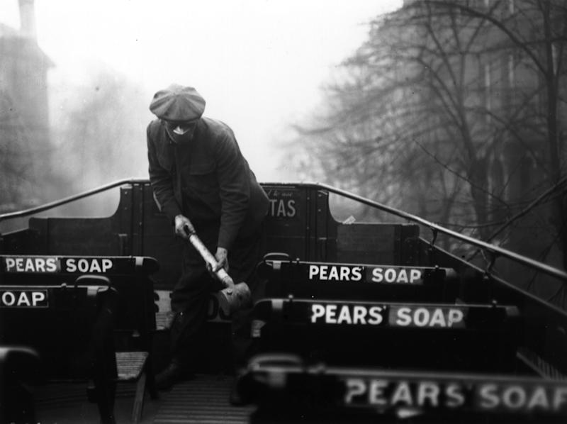 A man spraying the top of a bus with an anti-flu virus during an epidemic which followed World War I. (Photo by Davis/Getty Images)