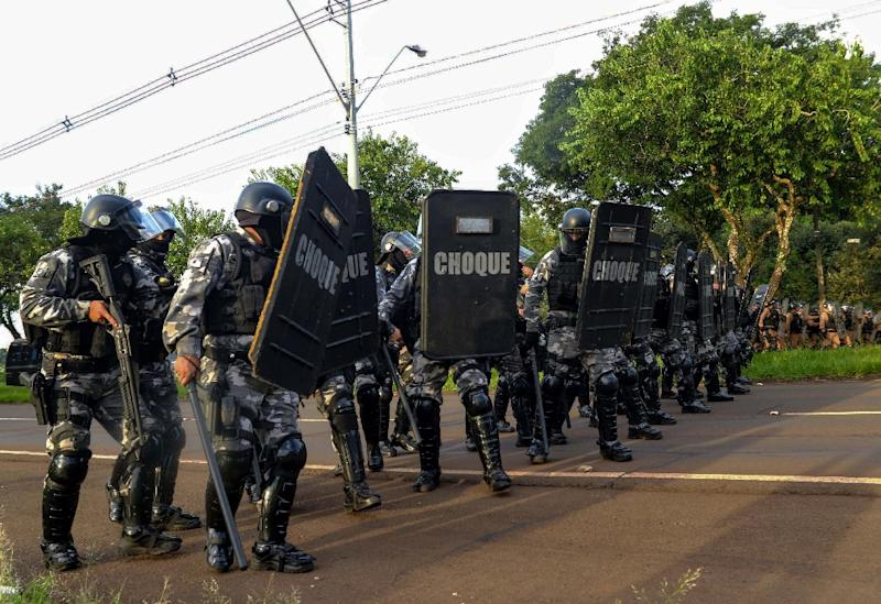 """Police in the Brazilian state of Parana, seen here in riot gear at a political rally March 26, 2018, have dropped """"masculinity"""" as an attribute required of new recruits"""