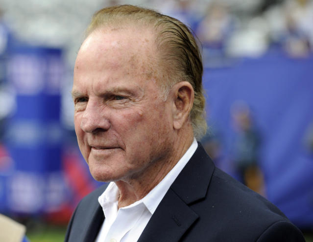 FILE - In this Sept. 15, 2013, file photo, former New York Giants player Frank Gifford looks on before an NFL football game between the Giants and the Denver Broncos in East Rutherford, N.J. The Hall of Fame running back went on to have a career as one of the most versatile announcers in football history. (AP Photo/Bill Kostroun, File)