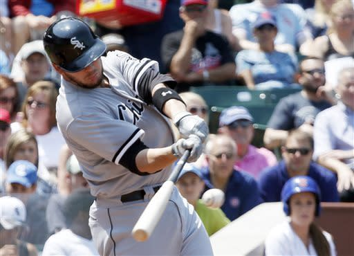 Chicago White Sox's Tyler Flowers hits an RBI single off Chicago Cubs starting pitcher Scott Feldman, scoring Conor Gillaspie, during the second inning of a interleague baseball game Wednesday, May 29, 2013, in Chicago. (AP Photo/Charles Rex Arbogast)