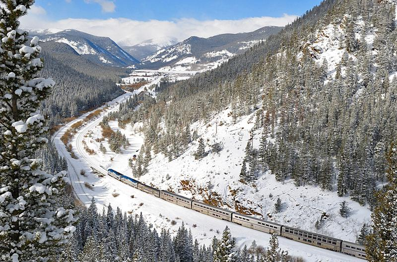 This undated image provided by Amtrak shows the California Zephyr train on a snowy route passing through Rocklin, Calif. The Zephyr's journey from its starting point, Emeryville, Calif., to Reno, Nev., is a 236-mile route that offers beautiful views as well as history. It crosses the Sierra Nevada mountain range and follows the same course as the historic Transcontinental Railroad, a 19th century engineering feat that bolstered the nation's western expansion. The Zephyr's ultimate destination is Chicago, a 51-hour trip from Emeryville. (AP Photo/Amtrak, Phil Gosney)