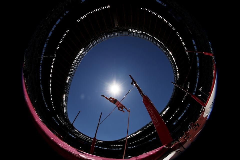 <p>Vitaliy Zhuk of Team Belarus competes in the Men's Decathlon Pole Vault on day thirteen of the Tokyo 2020 Olympic Games at Olympic Stadium on August 05, 2021 in Tokyo, Japan. (Photo by Cameron Spencer/Getty Images)</p>