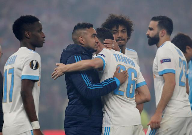 Soccer Football - Europa League Final - Olympique de Marseille vs Atletico Madrid - Groupama Stadium, Lyon, France - May 16, 2018 Marseille's Dimitri Payet looks dejected with Florian Thauvin and team mates after the match REUTERS/Christian Hartmann