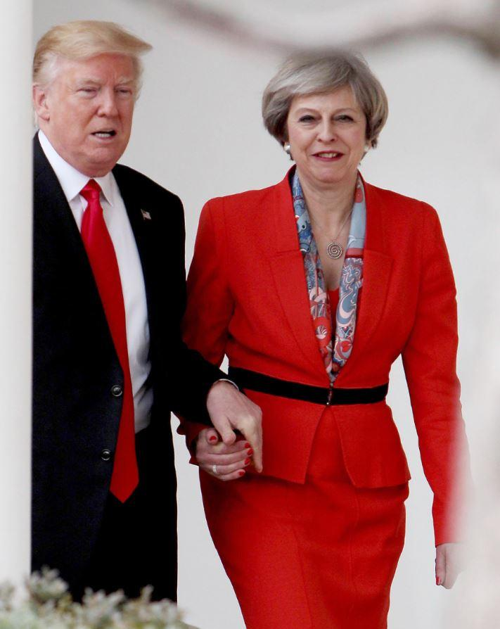Donald Trump and Theresa May pictured during their famous hand-holding moment in Washington in January (Rex)