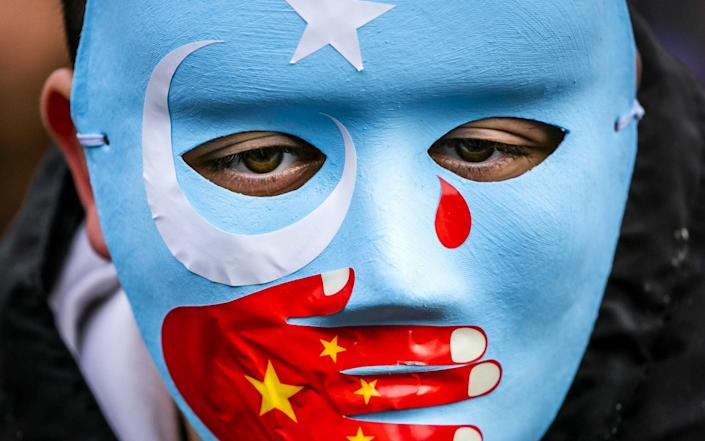 Members of the Uighur community and sympathizers demonstrate