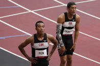 Nathan Crumpton, of American Samoa, reacts after competing in a heat in the men's 100-meter run at the 2020 Summer Olympics, Saturday, July 31, 2021, in Tokyo. (AP Photo/Charlie Riedel)