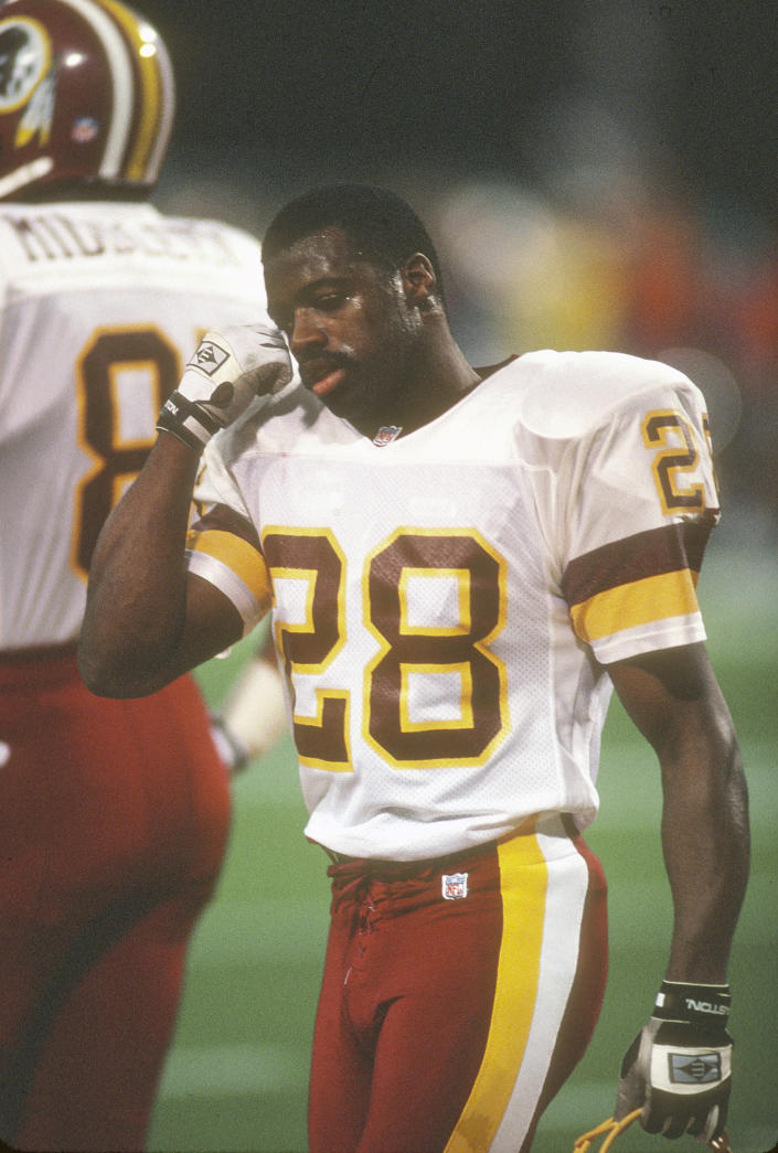 Darrell Green #28 of the Washington football team looks on while walking off the field during an NFL football game circa 1991. (Focus On Sport / Getty Images)