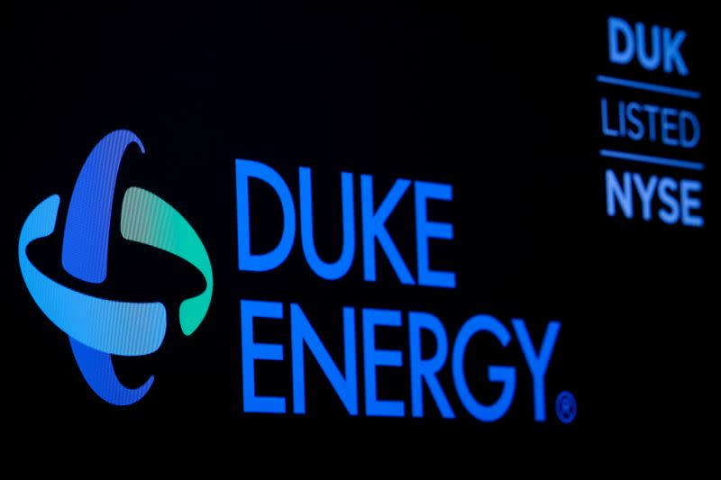 FILE PHOTO: The company logo and ticker for Duke Energy Corp. is displayed on a screen on the floor of the NYSE in New York