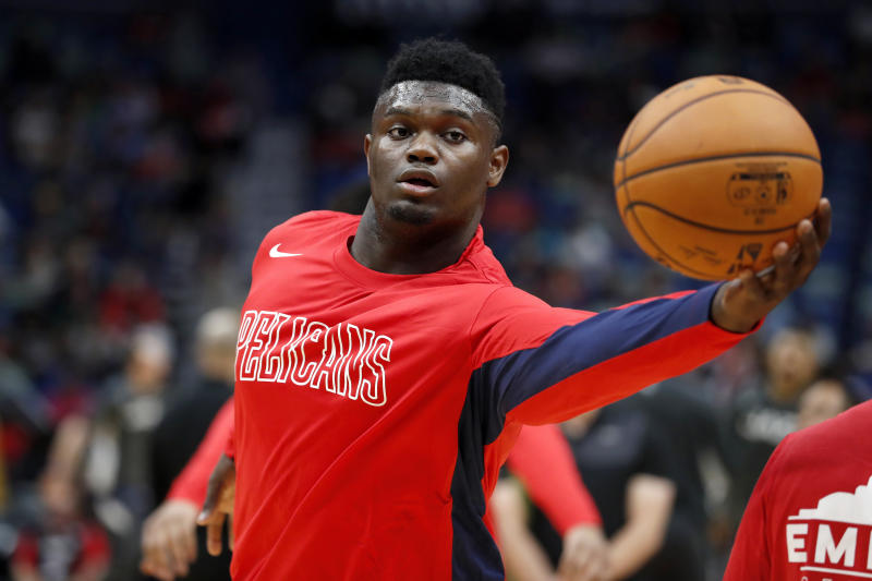 New Orleans Pelicans forward Zion Williamson (1) warms up before a preseason NBA basketball game against the Utah Jazz in New Orleans, Friday, Oct. 11, 2019. (AP Photo/Tyler Kaufman)