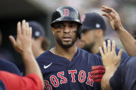 Boston Red Sox's Xander Bogaerts celebrates scoring against the Detroit Tigers in the first inning of a baseball game in Detroit, Tuesday, Aug. 3, 2021. (AP Photo/Paul Sancya)