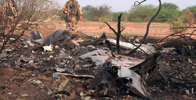CLICK IMAGE for slideshow: This photo provided Friday July 25, 2014 by the French army shows soldiers at the site of the plane crash in Mali. French soldiers secured a black box from the Air Algerie wreckage site in a desolate region of restive northern Mali on Friday, the French president said. Terrorism hasn't been ruled out as a cause, although officials say the most likely reason for the catastrophe that killed all onboard is bad weather. At least 116 people were killed in Thursday's disaster, nearly half of whom were French. (AP Photo/ECPAD)