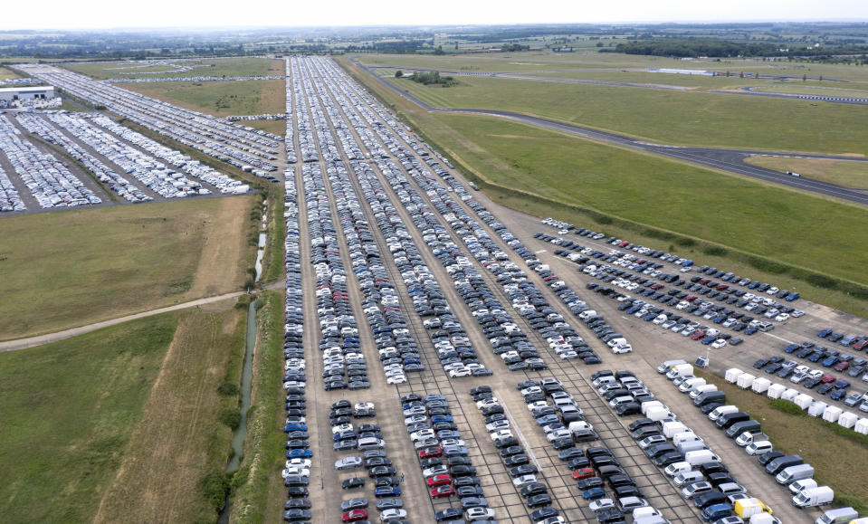 THURLEIGH, BEDFORDSHIRE - JUNE 09: Thousands of unwanted new and used cars line up on June 09, 2020, at Thurleigh Airfield in Bedfordshire. Britain's economy slumped by 20.4% in April in the biggest monthly decline since records began as the coronavirus lockdown paralyzed the country. (Permission from Aerodrome for flight). (Photo by Chris Gorman/Getty Images)