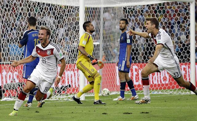 Germany's Mario Goetze, left, celebrates after scoring the opening goal during the World Cup final soccer match between Germany and Argentina at the Maracana Stadium in Rio de Janeiro, Brazil, Sunday, July 13, 2014. (AP Photo/Victor R. Caivano)