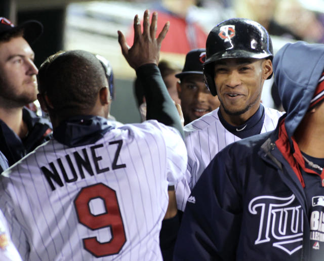 Minnesota Twins' Pedro Florimon is congratulated by teammate Eduardo Nunez after he scored the go-ahead run on a wild pitch by Toronto Blue Jays relief pitcher Sergio Santos during the eighth inning of the second game of a baseball doubleheader, Thursday, April 17, 2014, in Minneapolis. Minnesota won 9-5. AP Photo/Paul Battaglia)