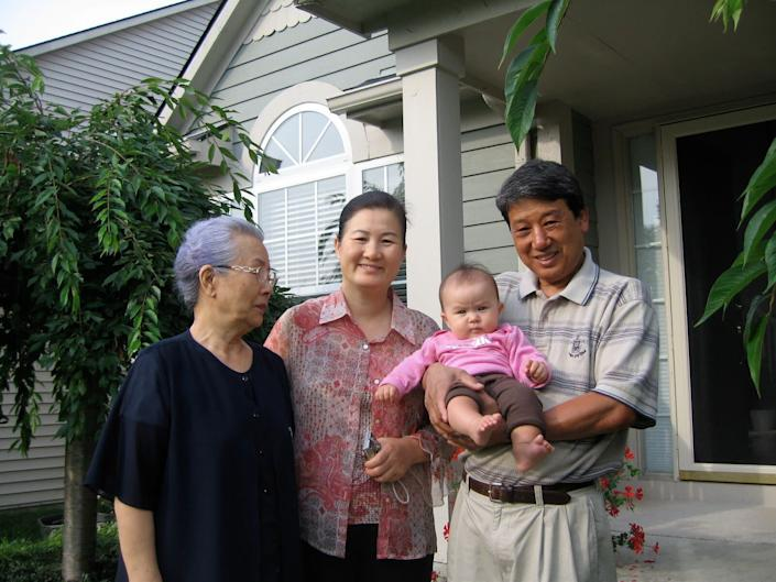 Stanton Lee's daughter, Madigan, with great-grandmother Myung Namm (left), grandmother Mi Ja Lee (center) and grandfather Jai Ho Lee in 2008. (Photo: Courtesy of Kendra Stanton Lee)