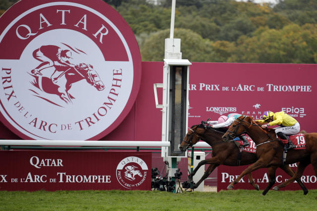 Italian Lanfranco Dettori riding British horse Enable, left, ahead of JW Doyle riding Irish horse Sea of Class, right, crosses the finish line to win the Qatar Prix de l'Arc de Triomphe horse race at the Longchamp horse racetrack, outskirts of Paris, France, Sunday, Oct. 7, 2018. (AP Photo/Francois Mori)