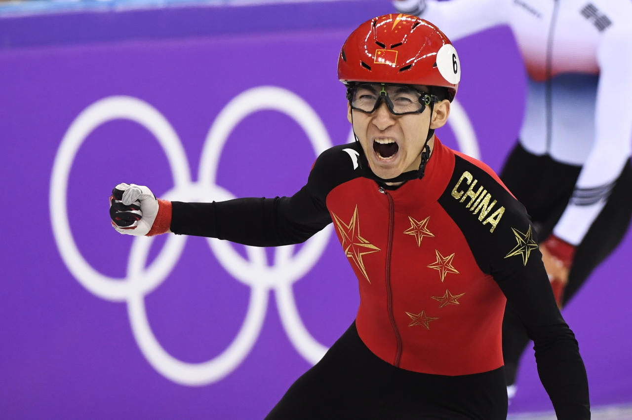 <p>Wu Dajing of China celebrates after winning the Men's 500m Short Track Speed Skating A Final at the PyeongChang 2018 Winter Olympics in South Korea, on Feb. 22, 2018.<br /> (Paul Chiasson/The Canadian Press via AP) </p>