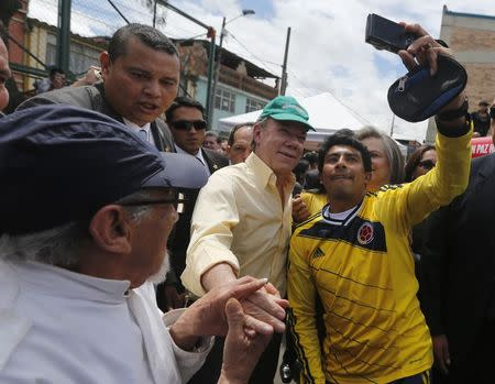 Colombia's President and presidential candidate Juan Manuel Santos greets supporters during a campaign rally in Bogota