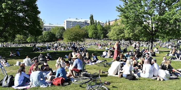 People sit in Tantolunden park in Stockholm on May 30, 2020.