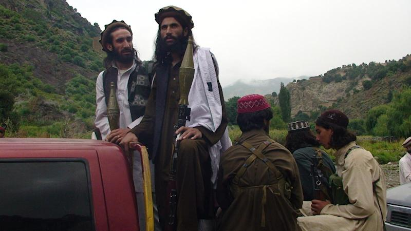 In this photo taken on Aug. 5, 2012 Pakistani Taliban patrol in their stronghold of Shawal in Pakistani tribal region of South Waziristan. Taliban leaders will hold a meeting to decide whether a Pakistani cricket star-turned-politician Imran Khan will be allowed to hold a planned march to their tribal stronghold to protest U.S. drone strikes, the militant group's spokesman said Thursday. (AP Photo/ Ishtiaq Mahsud)
