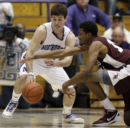 Northwestern guard Dave Sobolewski, left, and Texas Southern forward D'Angelo Scott battle for a loose ball during the first half of an NCAA college basketball game in Evanston, Ill., on Thursday, Dec. 15, 2011. (AP Photo/Nam Y. Huh)