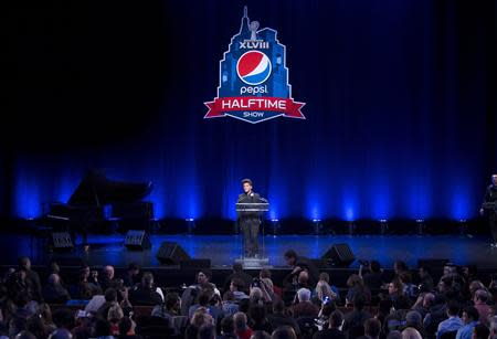 Singer Bruno Mars speaks at the Super Bowl half time press conference in New York January 30, 2014. REUTERS/Carlo Allegri