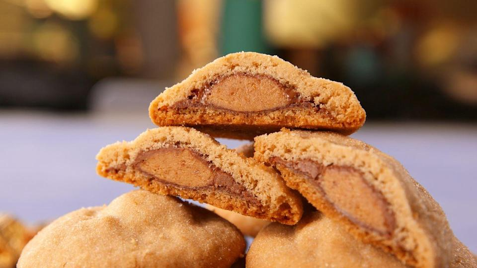 "<p>Yup, there's an entire Mini Reese's Cup inside each one of these. </p><p>Get the recipe from <a href=""https://www.delish.com/cooking/recipe-ideas/a19473555/reeses-stuffed-cookies-recipe/"" rel=""nofollow noopener"" target=""_blank"" data-ylk=""slk:Delish"" class=""link rapid-noclick-resp"">Delish</a>. </p>"