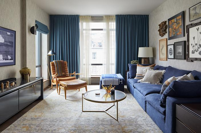 "<div class=""caption""> The living room is where the couple spend the most time, often curled up on the <a href=""https://www.restorationhardware.com/"" rel=""nofollow noopener"" target=""_blank"" data-ylk=""slk:RH"" class=""link rapid-noclick-resp"">RH</a> couch watching the <a href=""https://www.samsung.com/us/"" rel=""nofollow noopener"" target=""_blank"" data-ylk=""slk:Samsung"" class=""link rapid-noclick-resp"">Samsung</a> Frame TV. ""I don't know why I don't have one in every room now, because they're so beautiful,"" Ferguson says of the TV. The rug and leather chair are from <a href=""http://www.abchome.com/"" rel=""nofollow noopener"" target=""_blank"" data-ylk=""slk:ABC Carpet & Home"" class=""link rapid-noclick-resp"">ABC Carpet & Home</a>, the sideboard is <a href=""https://www.lanobadesign.com/"" rel=""nofollow noopener"" target=""_blank"" data-ylk=""slk:Lanoba Design"" class=""link rapid-noclick-resp"">Lanoba Design</a>, and the wallpaper is from <a href=""https://www.phillipjeffries.com/"" rel=""nofollow noopener"" target=""_blank"" data-ylk=""slk:Phillip Jeffries"" class=""link rapid-noclick-resp"">Phillip Jeffries</a>. </div>"