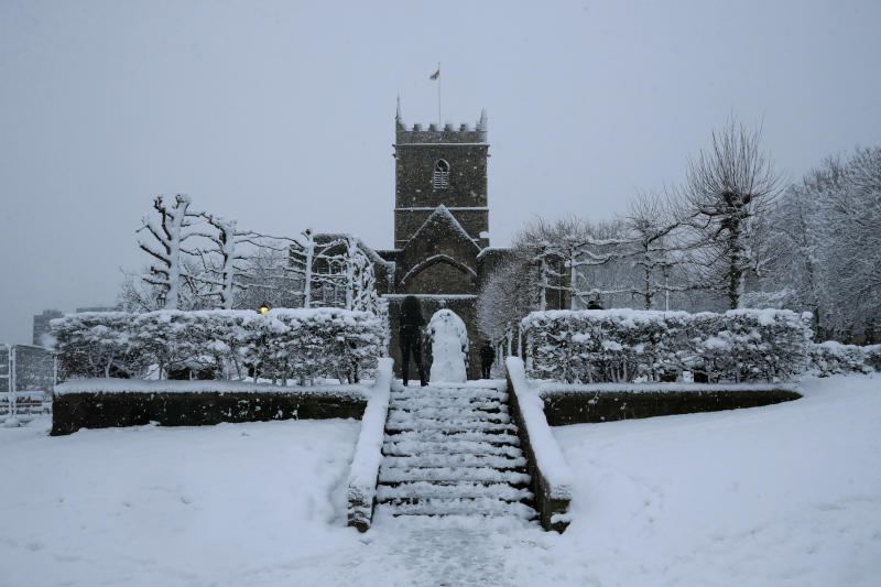 Snow falls over St Peter's Church in Bristol, south west England, Friday, Feb. 1, 2019. (AP Photo/Matt Dunham)