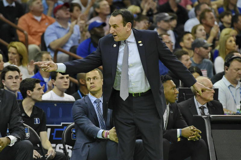 CORRECTS TO SECOND ROUND NOT FIRST Duke coach Mike Krzyzewski gestures during the first half of a second round men's college basketball game against Central Florida in the NCAA Tournament in Columbia, S.C. Sunday, March 24, 2019. (AP Photo/Richard Shiro)
