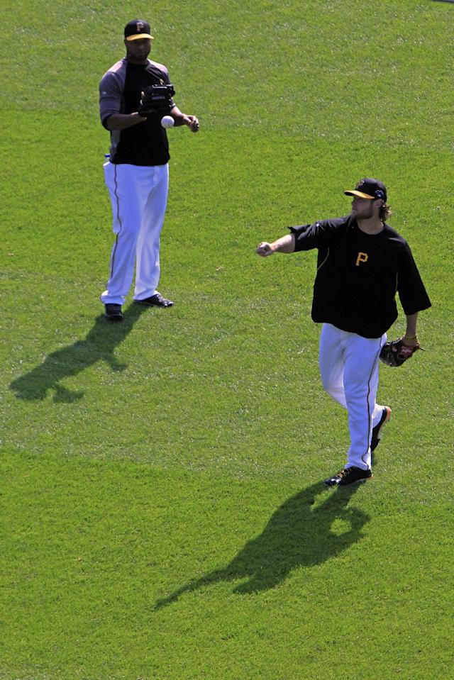Pittsburgh Pirates pitchers Garrett Cole, right, and Francisco Liriano warm up before Game 4 of a National League division baseball series against the St. Louis Cardinals on Monday, Oct. 7, 2013, in Pittsburgh. (AP Photo/Gene J. Puskar)