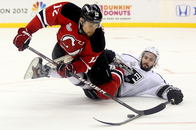 NEWARK, NJ - JUNE 09: Alexei Ponikarovsky #12 of the New Jersey Devils tries to handle the puck against Drew Doughty #8 of the Los Angeles Kings during Game Five of the 2012 NHL Stanley Cup Final at the Prudential Center on June 9, 2012 in Newark, New Jersey. (Photo by Elsa/Getty Images)