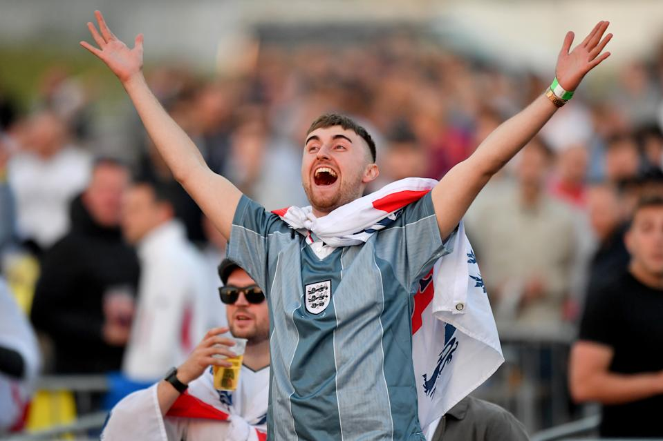 Supporters celebrate at the final whistle at the 4TheFans fan park in Manchester on Tuesday after England beat the Czech Republic 1-0 to finish top of their group in the Euros
