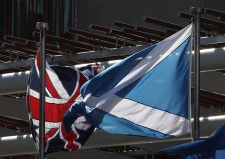 The Union flag and The Scottish Saltire fly at the Scottish Parliament ahead of a referendum debate in Edinburgh Scotland