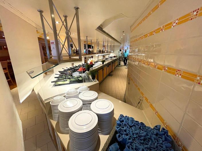 Utensils and plates were at the start of every buffet line.