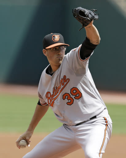Baltimore Orioles starting pitcher Kevin Gausman delivers in the first inning of a baseball game against the Cleveland Indians, Sunday, Aug. 17, 2014, in Cleveland. (AP Photo/Tony Dejak)