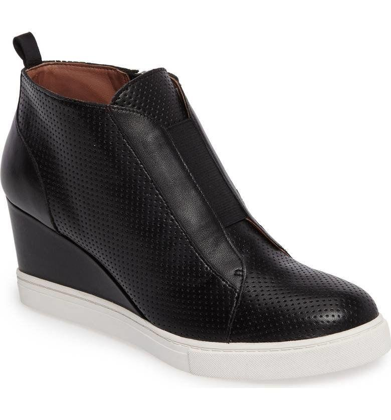 "Get it at <a href=""https://shop.nordstrom.com/s/linea-paolo-felicia-wedge-bootie-women/4413353?origin=productBrandLink"" target=""_blank"">Nordstrom</a>, $120."