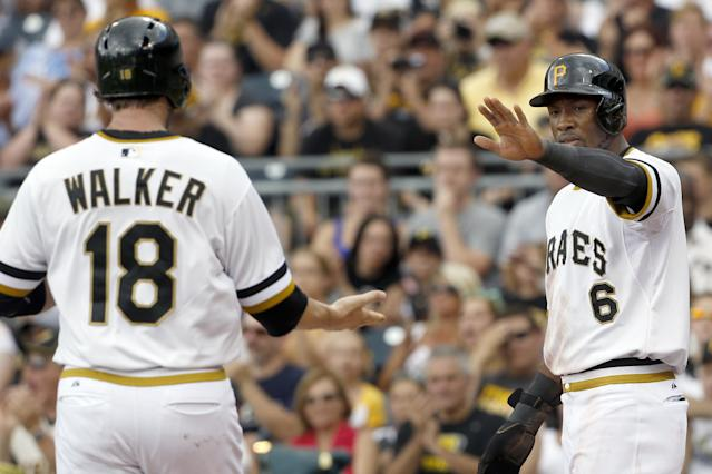 Pittsburgh Pirates' Starling Marte (6) greets Neil Walker (18) after they both scored on a hit by Ike Davis in the first inning of the baseball game against the New York Mets on Sunday, June 29, 2014, in Pittsburgh. (AP Photo/Keith Srakocic)