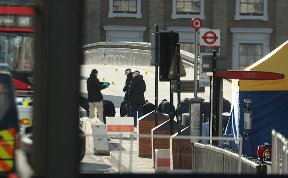 Forensic personnel searching for fingerprints at the cordoned off area on London Bridge in central London, after a terrorist wearing a fake suicide vest who went on a knife rampage killing two people, was shot dead by police on Friday. (Photo by Yui Mok/PA Images via Getty Images)