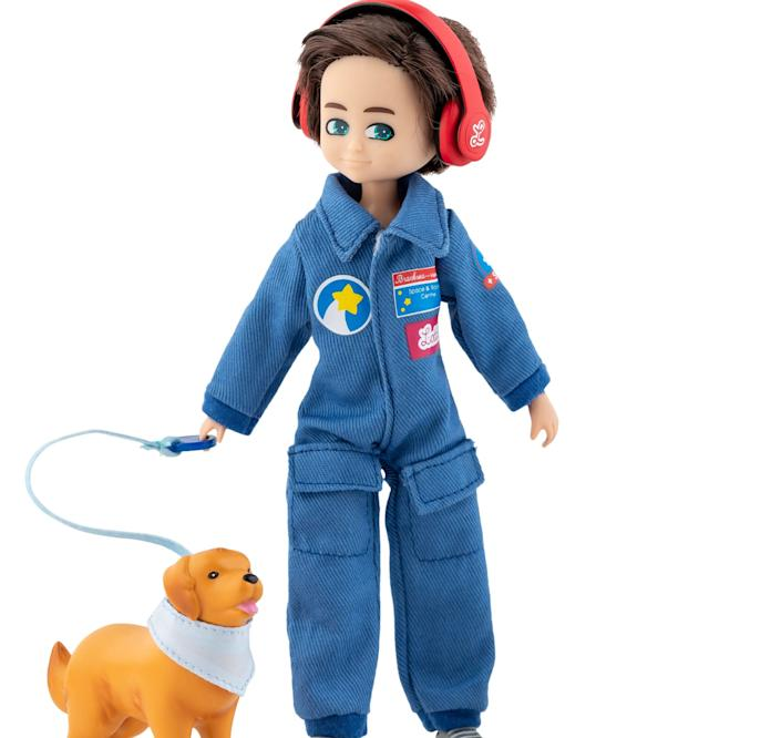 The Lottie Dolls play set inspired by a real boy with autism includes  headphones and sunglasses to assist with sensory issues and a companion dog.