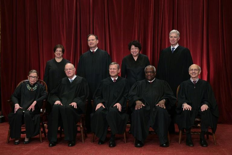 The current members of the US Supreme Court pose for a group photo with Justice Ruth Bader Ginsburg on the bottom left