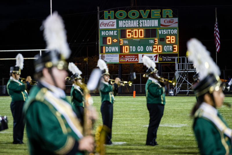 A scoreboard displays a 28-point deficit as Hoover High School competes during a home game in Des Moines, Iowa, Sept. 6, 2019.(KC McGinnis/The New York Times)