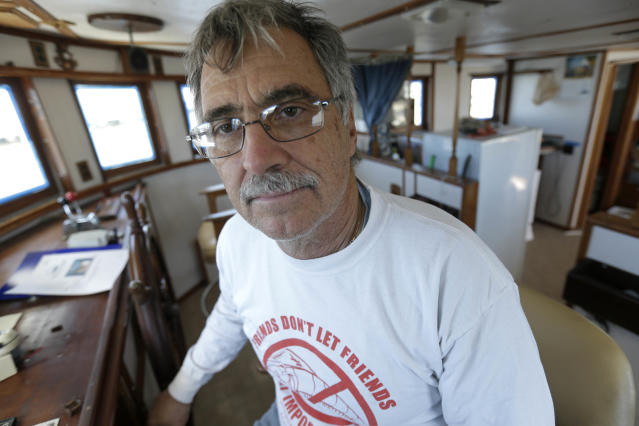 George Barisich poses for a photo on his boat in Chalmette, La., Friday, Feb. 28, 2014. When a BP oil well began gushing crude into the Gulf of Mexico four years ago, fisherman George Barisich used his boat to help clean up the millions of gallons of spew that would become the worst offshore spill in U.S. history. (AP Photo/Gerald Herbert)