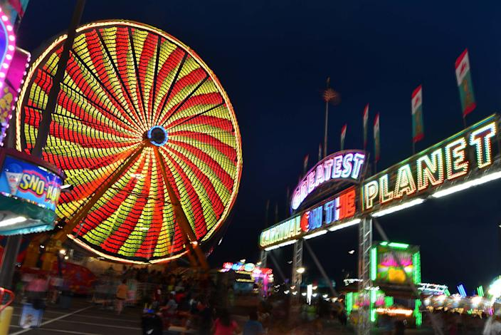 Colorful rides light up the Midway at the 100th Delaware State Fair in July 2019. This year's fair begins Thursday and masks must be worn to gain entry.