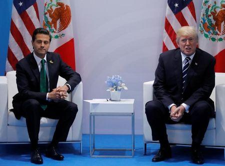 U.S. President Donald Trump meets Mexico's President Enrique Pena Nieto during the their bilateral meeting at the G20 summit in Hamburg, Germany July 7, 2017.    REUTERS/Carlos Barria