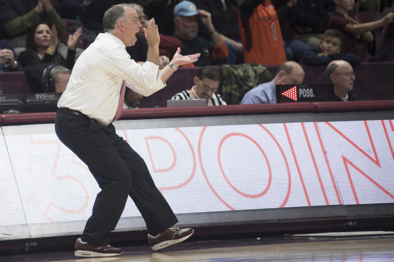 Virginia Tech head coach Mike Young cheers on his team against North Carolina during the second half of an NCAA college basketball game against North Carolina in Blacksburg, Va., Wednesday, Jan. 22, 2020.(AP Photo/Lee Luther Jr.)